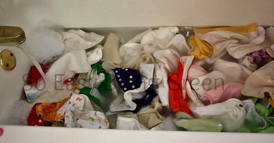 cloth diapers in bath tub with rockin green cloth diaper detergent