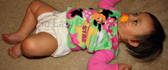 Baby laying down wearing Fitted Cloth Diaper