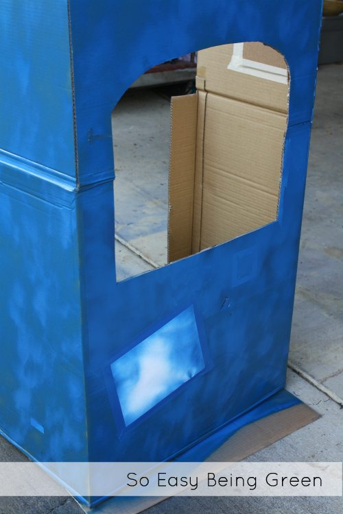 cut out of cardboard playhouse box painted blue