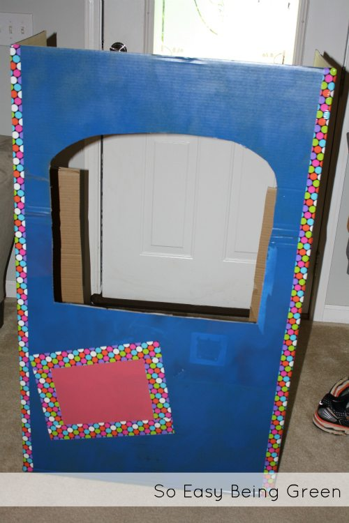 blue cardboard playhouse box with decorative duct tape