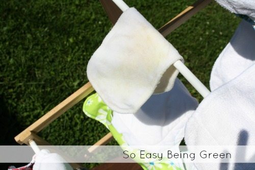 cloth diaper insert on drying rack in the sun