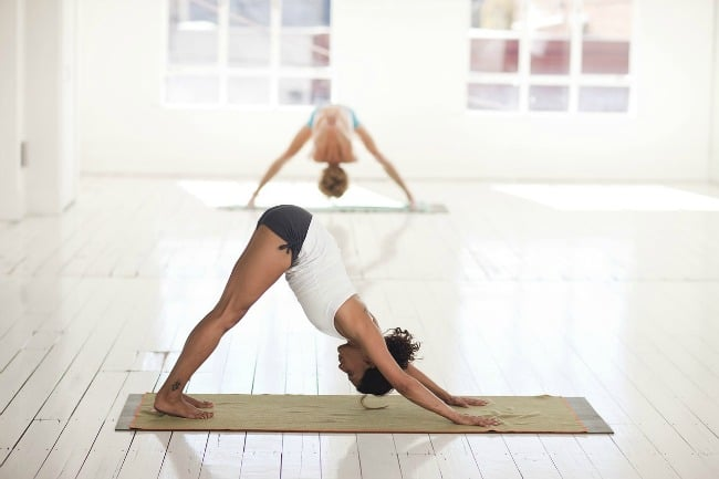 Women doing yoga at home