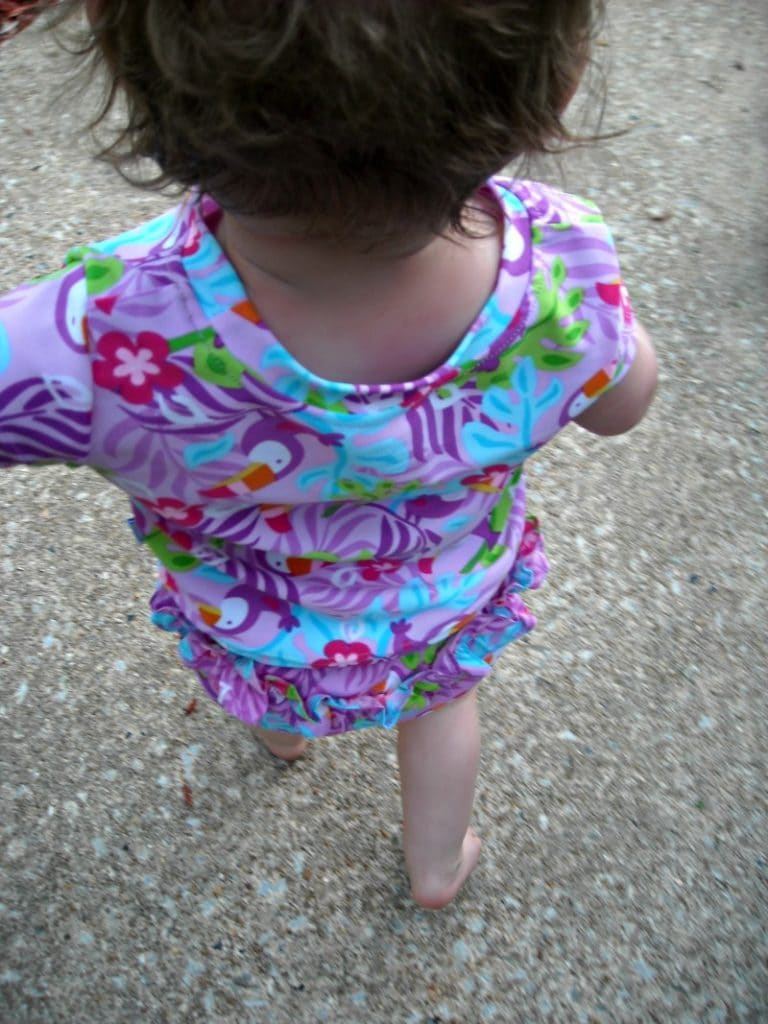 toddler wearing iplay rash guard and reusable swim diaper