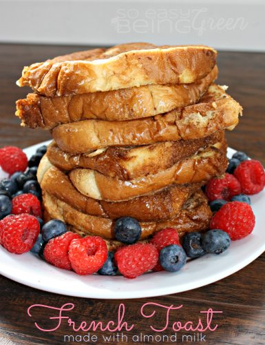 french toast stacked with berries on white plate