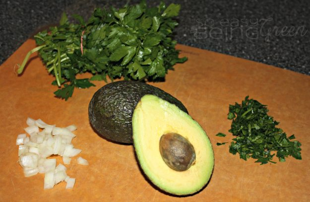 preparing herbs and avocado for chicken potato soup