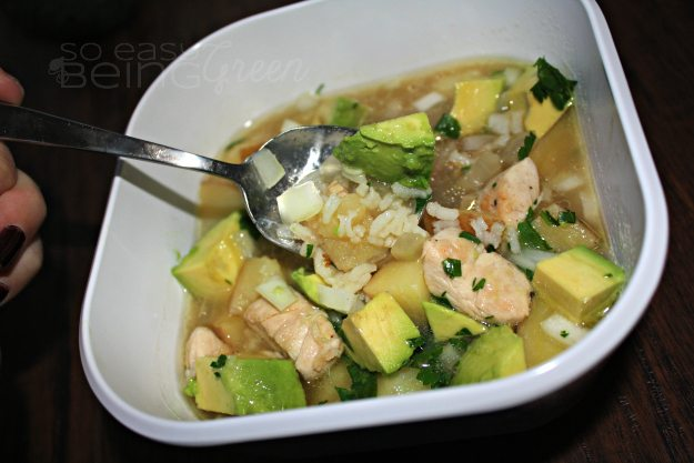 bowl of chicken potato soup with avocado and rice