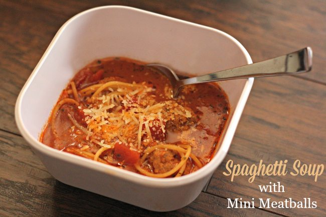 Spaghetti soup with mini meatballs in a bowl
