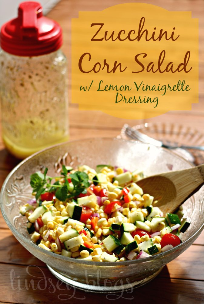 Zucchini Corn Salad with vinaigrette dressing in bowl with wooden spoon