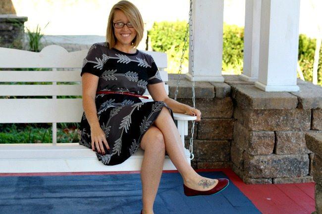 LuLaRoe Carly sitting on swing.