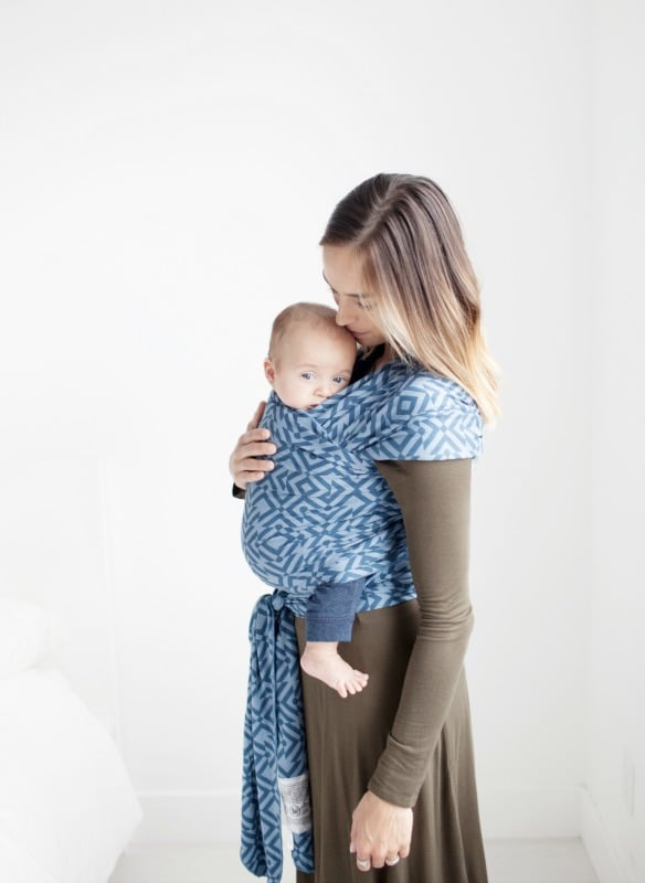 woman holding baby in moby wrap baby wrap