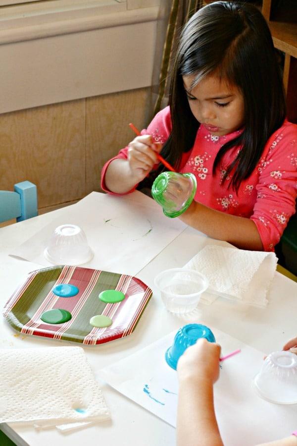 Painting sea turtles in floating sea turtle craft