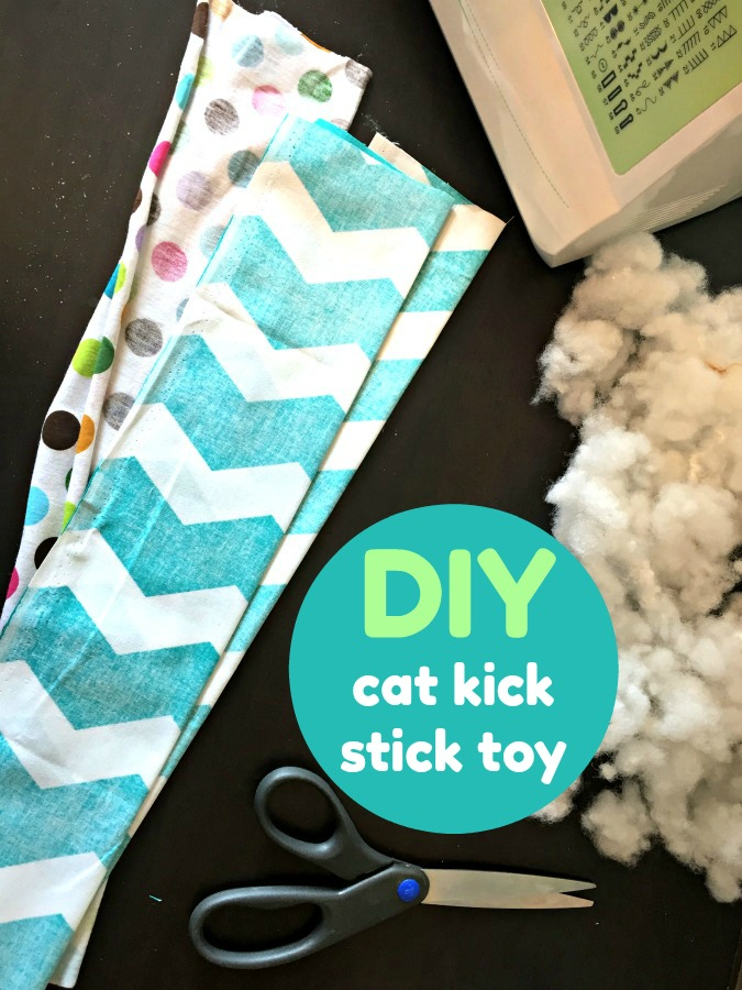 fabric, scissors, fabric bunting to make cat toy