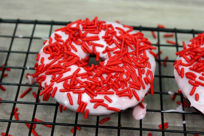 Red Velvet Cake Donuts with Red Sprinkles on cooling rack