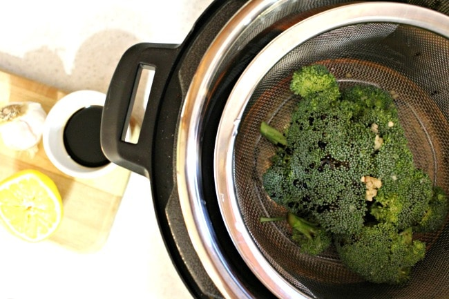 Steamed broccoli in Instant Pot with soy sauce lemon and garlic