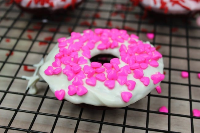 Red Velvet Donuts with Heart Sprinkles for Valentine's Day