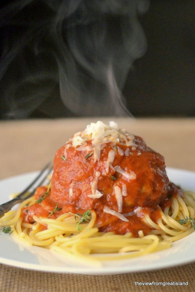 Spaghetti recipe - giant meatball on a plate of pasta