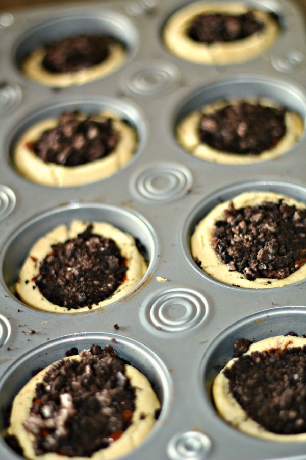 Homemade sugar cookie cups in muffin pan filled with nutella and oreos