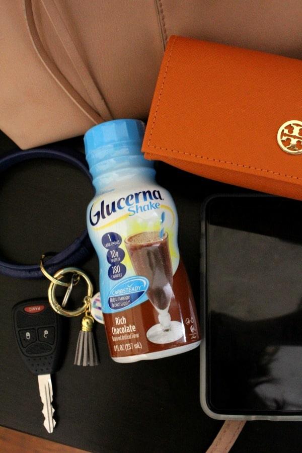keys glucerna shake sunglasses phone beside purse