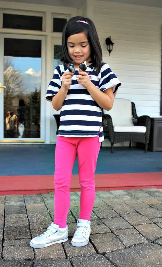 girl standing with see kai run shoes