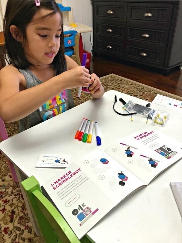 Girl making STEM toy from Circuit Cubes