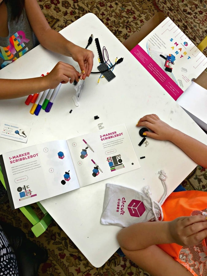 children putting together circuit cubes