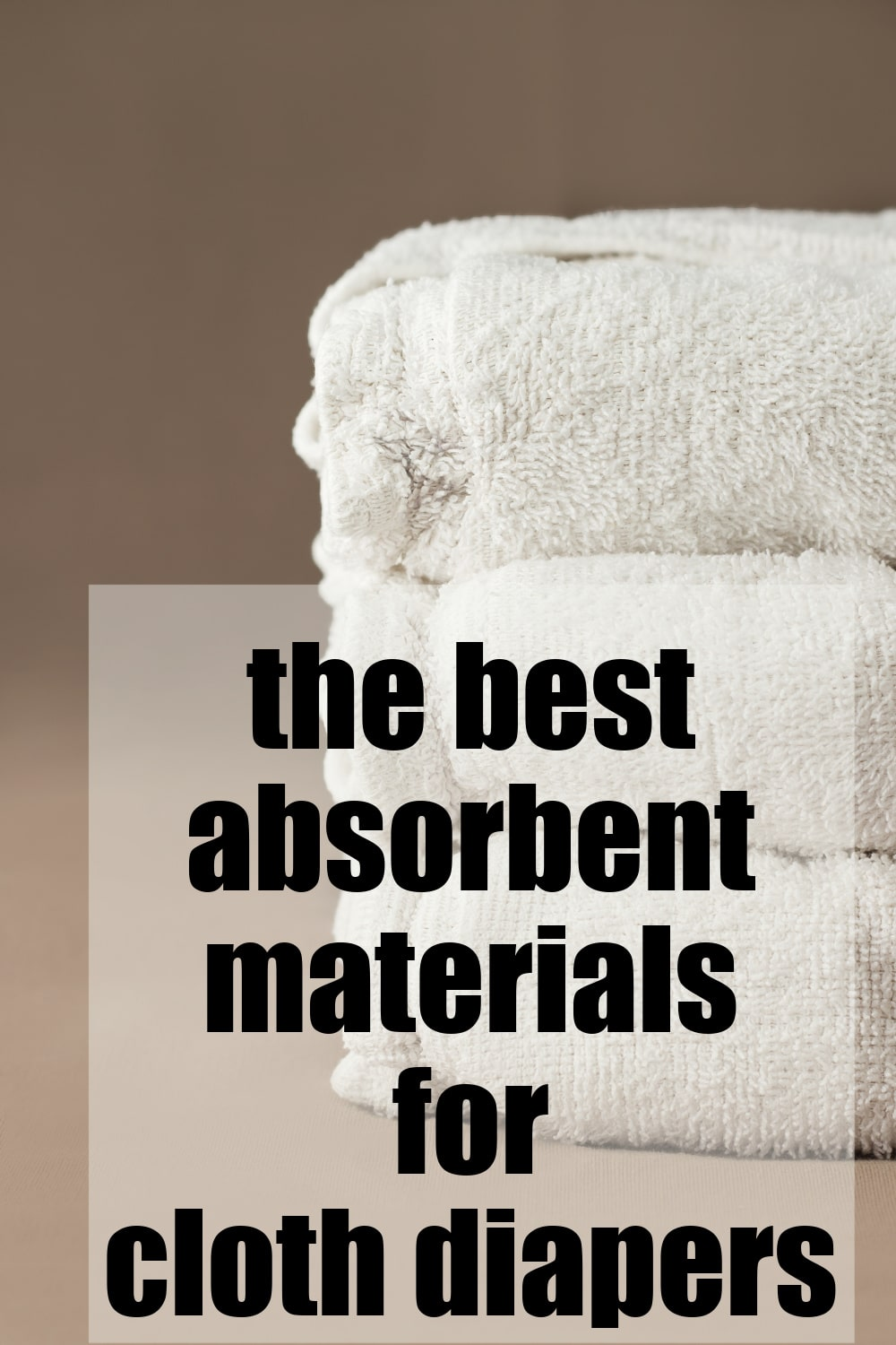 white cloth diapers stacked with text best absorbent materials for cloth diapers
