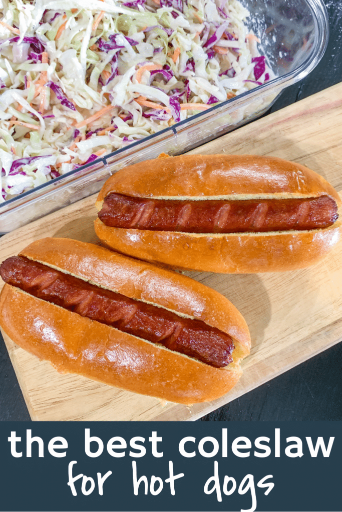 2 hotdogs in buns on cutting board with coleslaw with text the best coleslaw for hot dogs