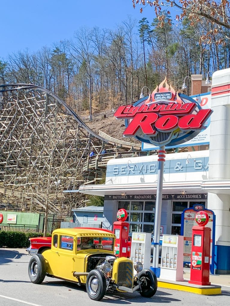 dollywood rollercoaster lightning rod with yellow car and old gas pumps