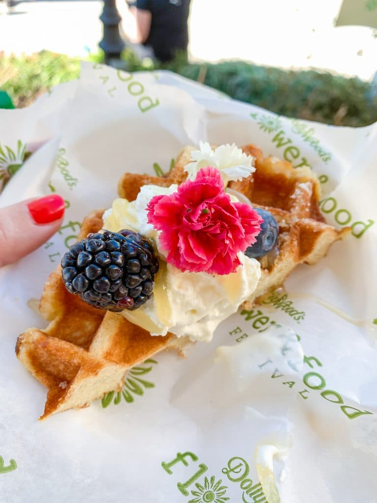 funnel cake waffle with cream and flowers dollywood flower and food festival food item