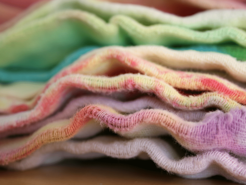 colorful cloth diaper inserts stacked