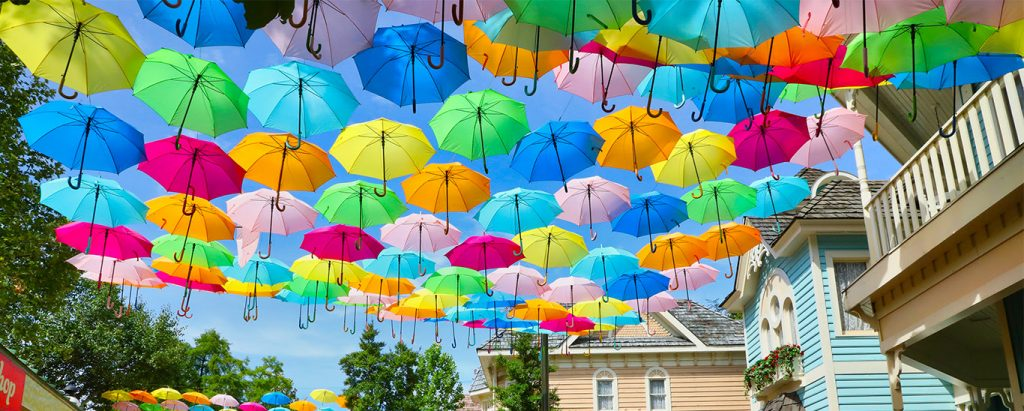 colorful umbrellas hanging in sky at dollywood