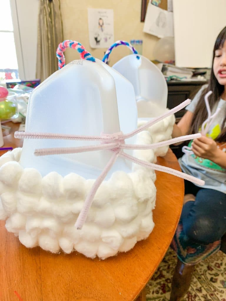 milk jug with cotton balls and pipe cleaners for bunny whiskers