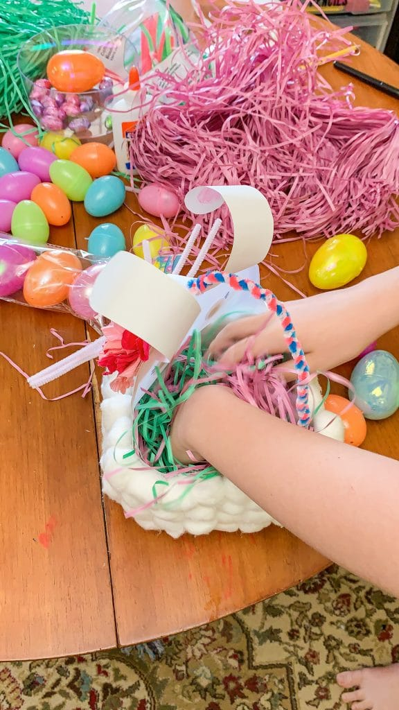 adding easter grass to easter basket