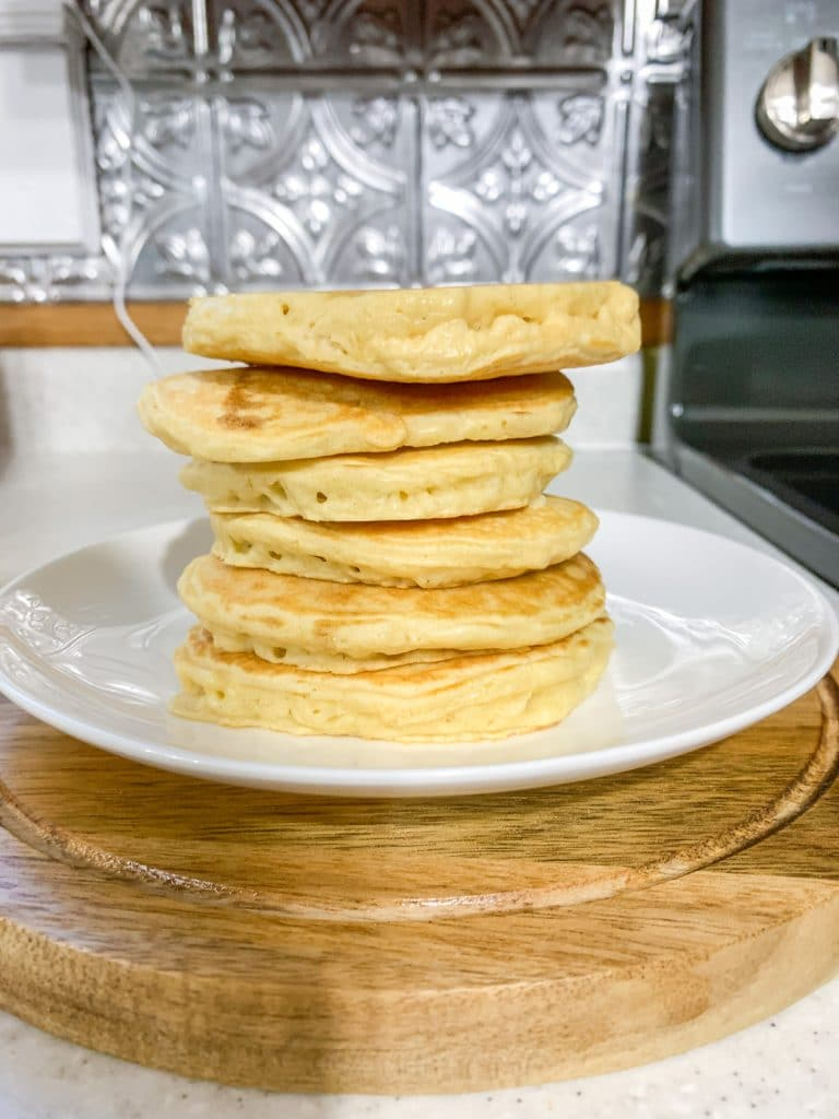 plate of stacked almond milk pancakes